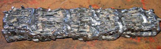 Hand forged Damascus blade out of chainsaw chain